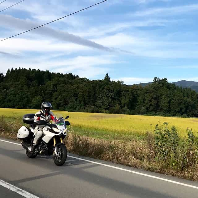 Ninjatours Japan motorcycle tour Hachimantai Naruko Onsen forest ride shady road on BMW RS1200