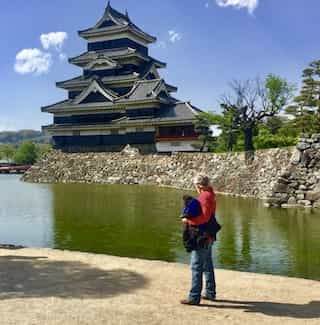 Japan motorcycle tour Matsumoto castle and moat enjoying the view