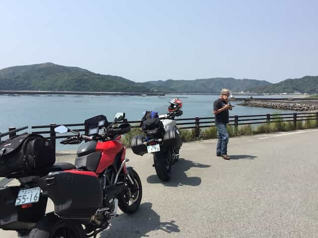 Japan motorcycle tour ninjatours ashizukuri kochi parking lot view of lake