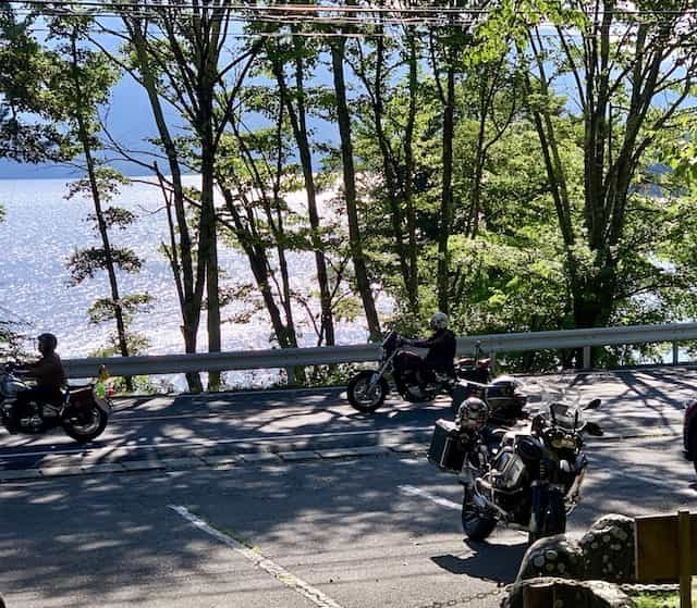 Japan motorcycle tours ninjatours tokyo kawamata parking area with trees