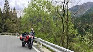 japan motorcycle tours ninjatours mt fuji kiso tree lined road with mountain view
