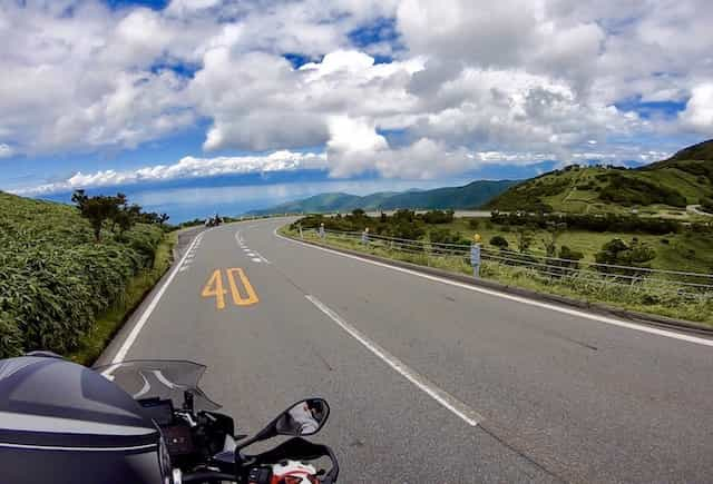 Japan motorcycle tour ninjatours tokyo nishi izu roadside with beautiful clouds