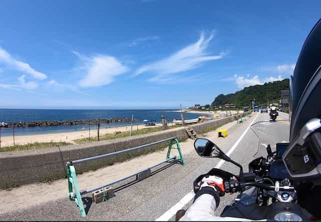 Ninjatours Japan motorcycle tour Yunohama parking area with motorcycles and blue skies with clouds