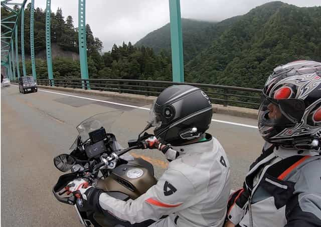 Ninjatours Japan motorcycle tour Pillion Hachimantai Naruko Onsen forest ride cloudy day road on BMW RS1200
