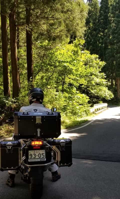 Ninjatours Japan motorcycle tour Hachimantai forest ride shady road on BMW RS1200